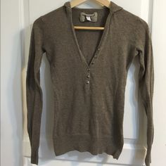 Brown hoodie This brown hoodie is made of a thin cotton sweater like material.  Open neck line with buttons, perfect for layering. Size small. Tops Sweatshirts & Hoodies