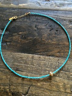 """Pearl encrusted solid 18k gold bead set with genuine high quality turquoise gemstones. Our favourite choker to date! Words cannot describe how beautiful this piece looks on. Length approx 14"""" adjustab"""