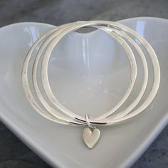 Cluster Of Heart Bangles by Kathy Jobson, the perfect gift for Explore more unique gifts in our curated marketplace. Sterling Silver Bracelets, Bangle Bracelets, Silver Jewelry, Bangles, Silver Ring, 925 Silver, Thoughtful Gifts For Her, Heart Shapes, Jewelery