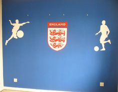 England Logo and silhouetted Footballers Mural