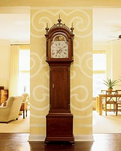 The grandfather clock against the wall that separates the living room and kitchen is a family heirloom that dates to the late 18th century. The stencil on the wall was inspired by a Celtic pattern that Lyne spotted in a magazine.