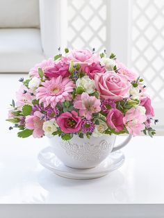 For a quirky twist on the traditional floral gift, this teacup and saucer arrangement is pretty and fun too. We've chosen a stunning array of glorious textures in shades of feminine pink and cream. A wonderful centrepiece for any room that's sure to be a talking point.<br /><br />Featuring 1 pink alstroemeria, 3 pink germini, 1 pink lisianthus, 2 pink roses, 2 white spray carnations, 1 pink spray chrysanthemum with eucalyptus, pittosporum and lavender, presented in a charming teacup and…