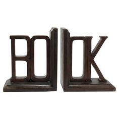 Brown-finished bookend with a typographic design.    Product: Set of 2 bookendsConstruction Material: Resin