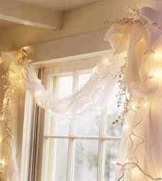 Lauren, do you like this window, dressing? Thinking this simple draping around the twinkle lights on the windows?