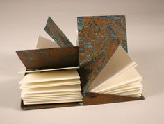 The magnificent copper books are by jeweler and metalsmith Jim Norton . To see more of his work go to his website . Bookbinding Materials, Paper Art, Paper Crafts, Book Journal, Journals, Mini Hands, Handmade Copper, Handmade Books, Book Binding