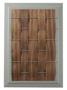 Bring nature into your kitchen with this wood-and-metal cabinet redo. Weave strips of wood over and under metal rods to create this design.