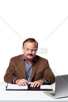 mature businessman working at desk. - Mature businessman working at desk over white background, Model: Dan Sanderson