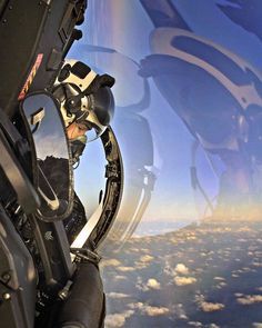"""A room with a view"": award winning archive photo of an RAF Typhoon pilot looking out from his ""office window"". pic.twitter.com/Eswq9SnLje"