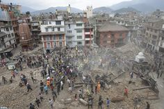 People search for survivors under the rubble of collapsed buildings in Kathmandu Durbar Sq...