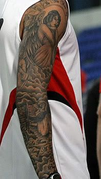 I like the use of clouds to fill in the empty space.-David Beckhams Arm. He has angel tattoos all over his body
