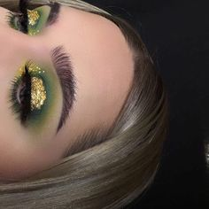 """✨☘ pot of gold ☘✨ inspired by @janeenersss -------------------------------------------- EYES: @morphebrushes 35C palette, @nyxcosmetics white liner and vivid halo, gold leaf from craft store, @urbandecaycosmetics perversion mascara BROWS: @anastasiabeverlyhills dipbrow in ash brown, clear brow gel LASHES: """"dreamy"""" from @certifeye SKIN: @makeupforeverofficial ultra hd foundation stick, @anastasiabeverlyhills cream and powder contour kit in light, @lauramercier translucent powder,"""