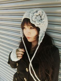 $34.00 handmade pale gray crochet hat at ETSY (New York City)     http://www.etsy.com/listing/63554708/gray-ear-flaps-hat-with-flower