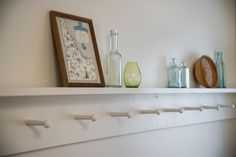 A shelf with pegs provides extra hanging space for guests.