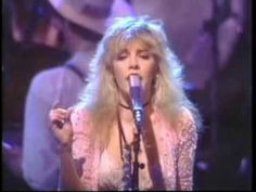 Fleetwood Mac, Mirage Tour concert, 1982 .. I got those photos from around 1:00:13 when Stevie gives Lindsey those looks.. some great looks between her and Mick, too, around 0:59:37.. love this concert! This is also the show with the speaking in tongues version of Sisters of the Moon.. 2nd to the last song.. much better quality than the stand-alone video.