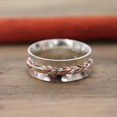 Excited to share the latest addition to my #etsy shop: Silver and Copper Twist Spinner Ring - hammered 925 Sterling spinner - Thumb ring - Silver spinner - Personalised - Worry Ring - Mixed metal
