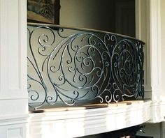 Jozef Custom Ironworks | Iron, Bronze, Curved Stair Railings, Spirals, Gates, Wrought iron interior railing in brushed metal finish. Very detailed and decorative piece. New Rochelle, NY 1995.