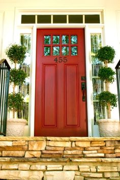 Red front door with small windows along the top with transom and full glass side lights - one of my favorites. by claudia