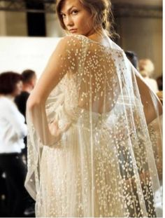 Gorgeous wedding cape rather than vail