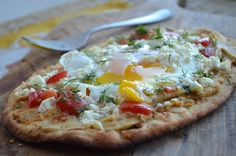 Tired of the same old breakfast? Try Breakfast Pizza with Hummus, Tomato, Feta, and Dill