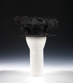 Mourning hat: ca. 1918 American silk, feathers Dimensions: 7 x 12 in. (17.8 x 30.5 cm)