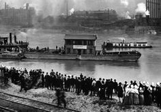 1904: a picture of the house where H.J. Heinz founded his company being floated down the Allegheny River in 1904. The structure was moved from its original location in Sharpsburg to the site of the Heinz factories on the North Side of Pittsburgh.