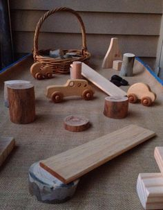 An invitation to play with loose parts and wooden vehicles. - Nurtured Learning Family day Care.