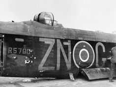 The damaged fuselage and mid-upper turret of Avro Lancaster B Mark I, R5700 'ZN-G', of No. 106 Squadron RAF , after crash-landing at Hardwick, Norfolk, following an attack by a German fighter .