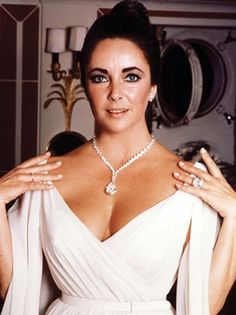 Throughout her career, Elizabeth Taylor amassed a collection of incredible pieces from the most famed fine jewelry designers. Some of Taylor's most iconic pieces include an Emerald Bulgari necklace, a Sapphire Bulgari necklace featuring a 321-carat Sapphire, and a white and yellow diamond daisy necklace by Van Cleef & Arpels. Of course, her most iconic piece is the Taylor-Burton Diamond, a 69.42-carat pear-shaped diamond, which cost over 1 million dollars and was set in a necklace by…