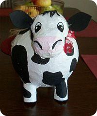 How to make a cow piñata using balloons.