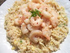 """Shrimp or Chicken Fried """"Rice""""  Ingredients: 2-3/4 cup grated cauliflower (5.75 Green) 1/4 cup green onion, chopped (.25 Green) 1/4 tsp garlic powder (.5 Condiment) 1/4 tsp ginger (.5 Condiment) 3 tbsp lite Soy Sauce (3 Condiments) 3 eggs beaten (1 Lean) 7 oz shrimp, cooked or 6 oz chicken, cooked and cubed (1 Lean) Dash of red pepper flakes (optional) 1 tsp olive oil - if using chicken or 2 tsp olive oil - if using shrimp  Directions: Cook eggs in skillet sprayed with a little bit"""
