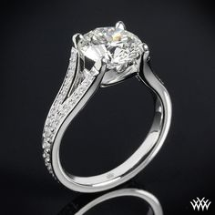 Katie Pave Diamond Engagement Ring combines timeless beauty with a modern design. Gleaming with 52 A CUT ABOVE® Hearts and Arrows Diamond Melee.