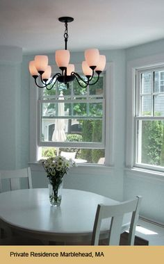 d0b2d68e614 traditional dining room chandelier with black iron and frosted glass