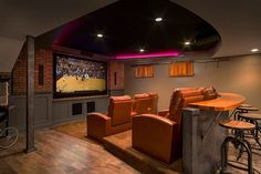 Custom designed bar adds to the appeal of the basement home theater