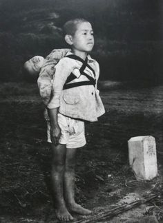 "Real-life Grave of the Fireflies: (Photo) Stoic Japanese orphan, standing at attention having brought his dead younger brother to a cremation pyre, Nagasaki, by Joe O'Donnell 1945 This photograph was taken by an American photojournalist, Joe O'Donnell, in Nagasaki in 1945. He recently spoke to a Japanese interviewer about this picture:  ""I saw a boy about ten years old walking by. He was carrying a baby on his back. In those days in Japan, we often saw children playing with their little…"