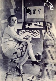 Sonia Delaunay in her studio - she was a Jewish-French artist who, with her husband Robert Delaunay and others, cofounded the Orphism art movement, noted for its use of strong colours and geometric shapes. http://en.wikipedia.org/wiki/Sonia_Delaunay