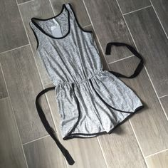 Gray Knit Romper Okay who doesn't want to wear rompers everyday? This one is perfection. Super soft and stretchy. Optional black tie at waist. Elastic waist and pockets on shorts. Easily hide a bra with this one. Opaque and not see through. Size small would best fit 0-4 Shorts
