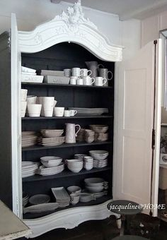 white hutch, black inside, white dishes . . . pretty much perfect . .  don't you think?