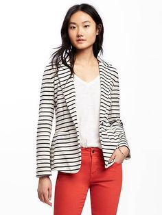 "Single button closure. Long sleeve, jersey-knit blazer with three decorative buttons. Welt pockets in front. 5"" back slit. Black and white stripes."