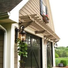 This Beautiful Garage Pergola over carriage garage door adds curb appeal & personalises your home with unique architectural accents. Wall Mounted Pergolas above garage doors are a great way to enhance your home. Carriage Garage Doors, Best Garage Doors, Carriage House, Garage Windows, Garage Pergola, Diy Pergola, Garage Trellis, Pergola Ideas, Diy Patio