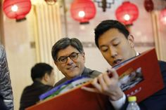 FOREIGN RELATIONS: U.S. Treasury Secretary Jacob Lew, left, chose dishes from a menu at a restaurant in Beijing on Tuesday. Mr. Lew met new Chinese President Xi Jinping on Tuesday. (Kim Kyung-Hoon/Reuters)