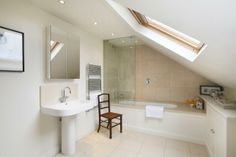 Bathroom in loft with sloping roof