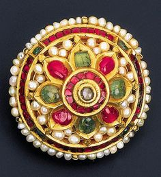 South India | Karnphul; circular ear-flower decorated with a ruby, emerald and diamond foliate cluster within a seed pearl surround | ca. early to mid 19th century | 2,300£ ~ sold Oct '99