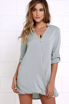 For a sweet and simple shift that can do it all, we adore the Twist and That Grey Dress! From a cute collared neckline, lightweight woven rayon descends into a V-neckline (with hidden modesty snap) and a wrapping surplice bodice with looping bottom hem. Long sleeves can be worn down or rolled up with button tabs.
