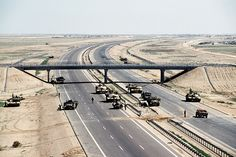 Tanks guard a US checkpoint along Highway 8, during Operation Desert Storm. | Persian Gulf War (1990-1991)