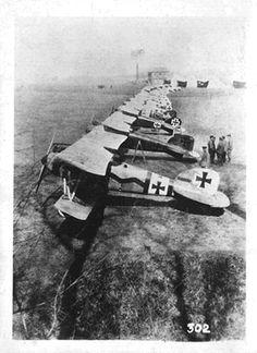 "From  a WW1 air war forum: ""Jasta 11 at La Brayelle Airfield, March 1917 (commanded by Rittmeister Manfred von Richthofen). 1st - Freftt, 2nd Richthofen's ""Petit Rouge"", 3rd - Wolff, 4th - Schäfer's black tail D.III."""