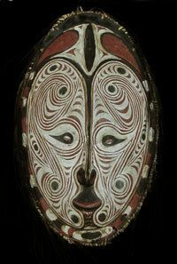 "Sepik River Area, Papua New Guinea 22 in, wood, ratan, natural pigments, feathers, shells  Carved on the back of this mask are the words ""New Guinea, 1944."" It may originally have been collected by a WWII vet. What I'm sure of is the high quality of the craftsmanship. Look at how beautifully the decorative lines are applied, and the other additions are equally well done. Sepik River art doesn't get more handsome than this. Excellent condition."