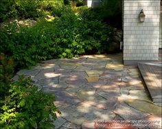 Stone Patio.  Rich-textured stone & planting detail. Wisconsin Chilton flagging. Credit: Tad Anderson Landscape Design, Minnetonka, MN. 952-473-8387.  All rights exclusively reserved.