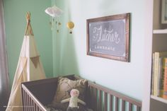 Love the chalkboard name art above crib! Such cute decorating ideas and items at this website -> iviebaby.com