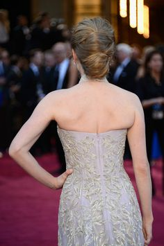 Amanda Seyfried's Hair : Cho used a diffuser to dry Amanda Seyfried's natural waves and misted them with Suave Lightweight Hold Hairspray. Once hair was teased at the crown, half of the hair was pulled into a midlevel bun. Then, the bottom of her hair at the nape was also secured in a bun.