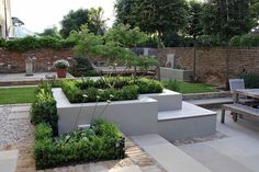 Square planter with seating incorporated, simple, clean and creative idea. clean looking colours